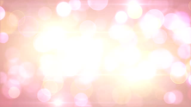 light-coloured pink yellow circle bokeh lights loop background video