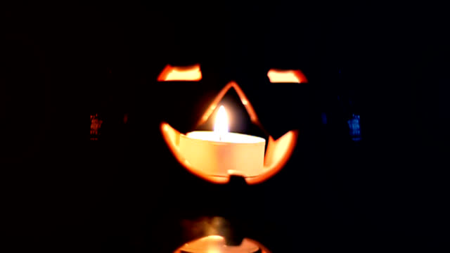 lighten pumpkin in darkness with red and blue side light video