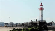 Lighthouse and pier in Trouville harbor, Normandy, France, Europe video