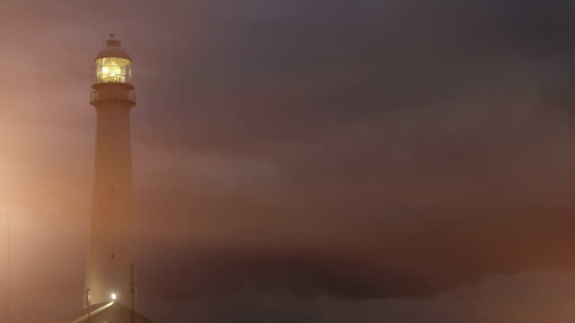 Lighthouse at night / dusk with lens flare video
