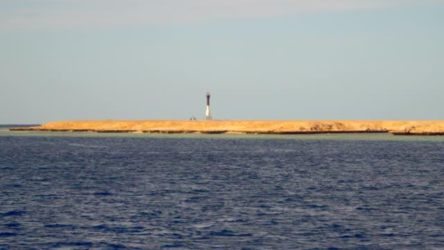 Lighthouse on a deserted beach video