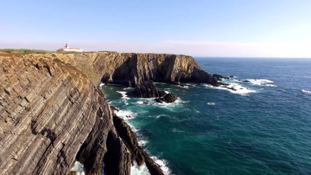 Lighthouse on cliff top - Cabo Sardao, Portugal aerial view video