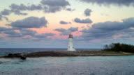Lighthouse on rocky coastline video