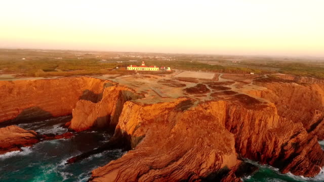 Lighthouse on the beautiful cliff at sunset in Portugal video