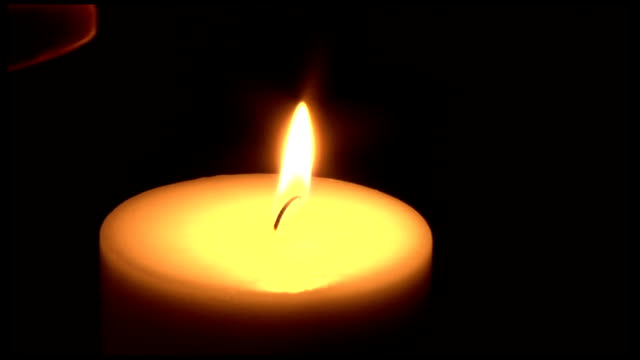 HD - Lighting a Candle for Memorial Vigil video