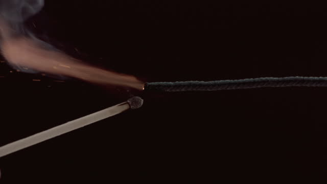 Lighting a fuse with match, slow motion video