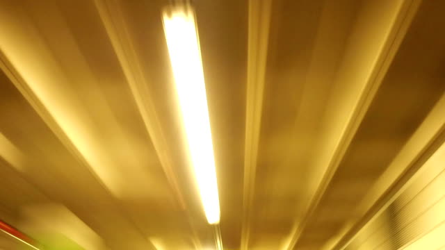 Lights and ceiling pipes of a garage - time lapse video