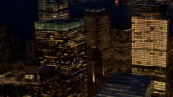 SLOW MOTION: Lights in office windows and skyscrapers glowing in the dark video