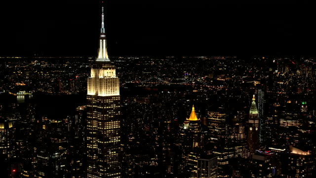 AERIAL: Lights on the top of Empire State Building shining at night in NYC video