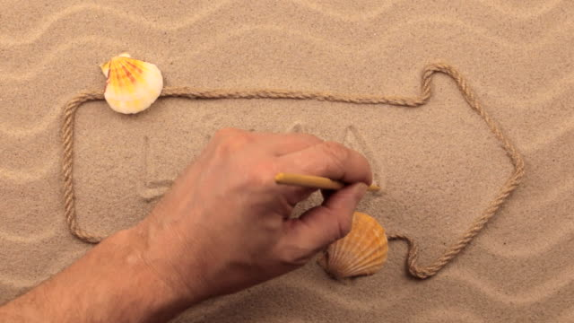 Lima inscription written by hand on the sand, in the pointer made from rope. video