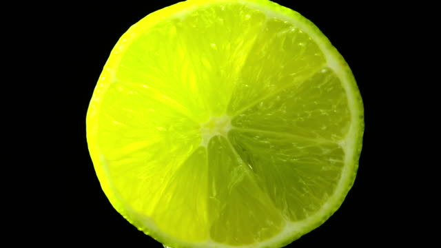 Lime fruit zoom in slowly with black background video
