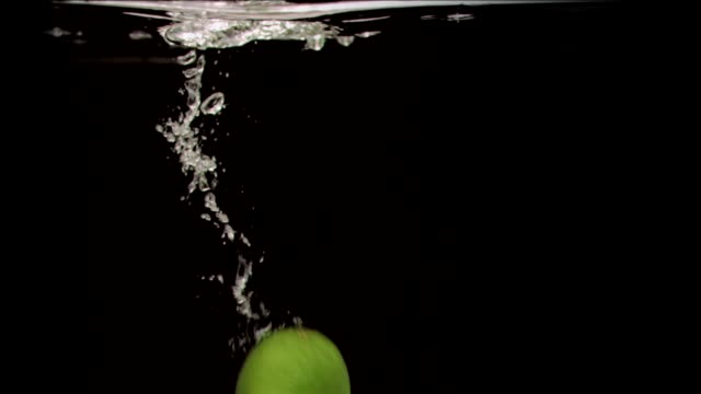 Lime in super slow motion dropping video