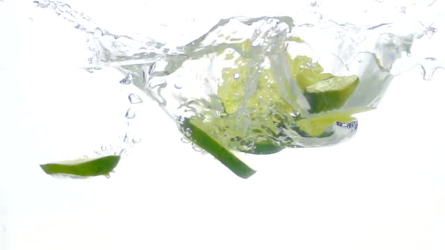 Lime Slices are Falling Through Water. video