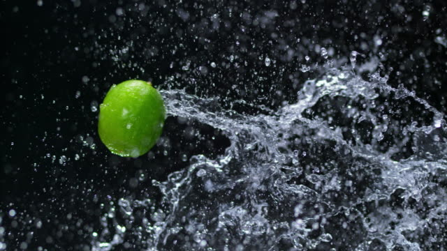 SLO MO Lime splashing through water in the air video