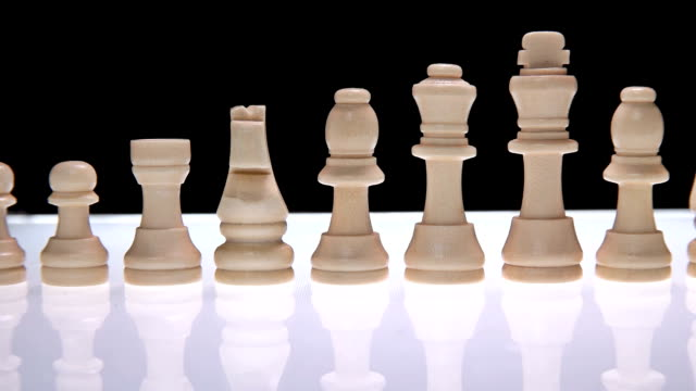 Line of chess pieces of white video