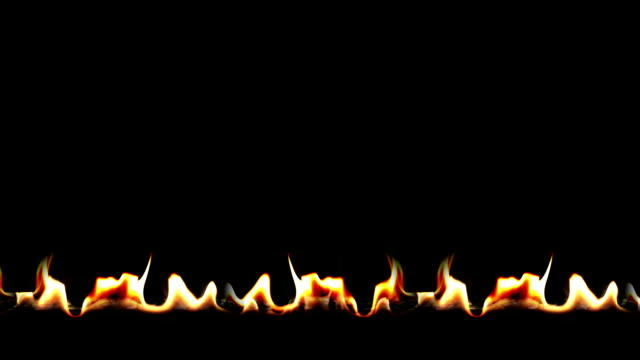 A line of slow motion fire over black.  Shot at 120fps. video