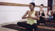 Line of young women in a zen-like pose video