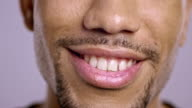 Lips of a young African-American male smiling video