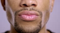 Lips of a young African-American male video