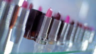 Lipstick variety of colors and shades on the store showcases sparkle in light video