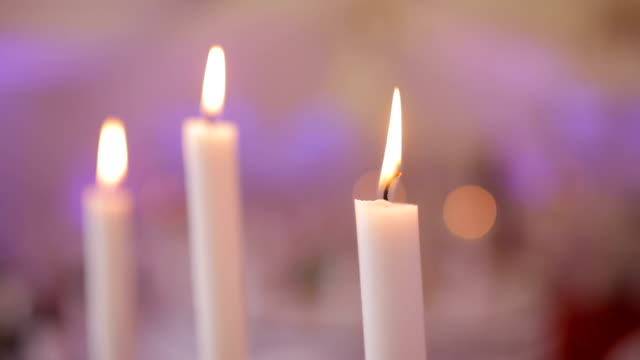 MEDIUM SHOT PANNING Lit candle surrounded with black tulle video