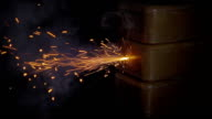 Lit fuse, fire comes to TNT charge and there is an explosion. Slow mo, slo mo video