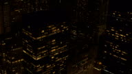 AERIAL: Lit skyscrapers and office buildings in downtown Manhattan at night video