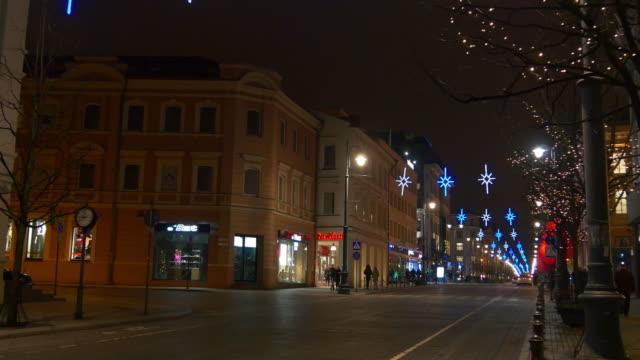 lithuania night light vilnius city center famous gediminas avenue walking panorama 4k video