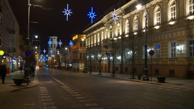 lithuania night light vilnius city center street walking panorama 4k video