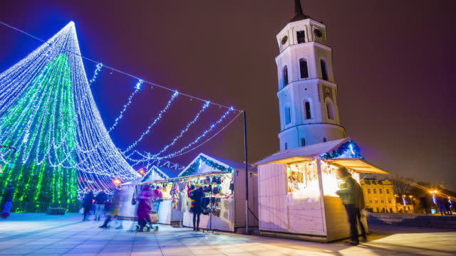lithuania night time famous vilnius cathedral square christmas market crowded panorama 4k time lapse video