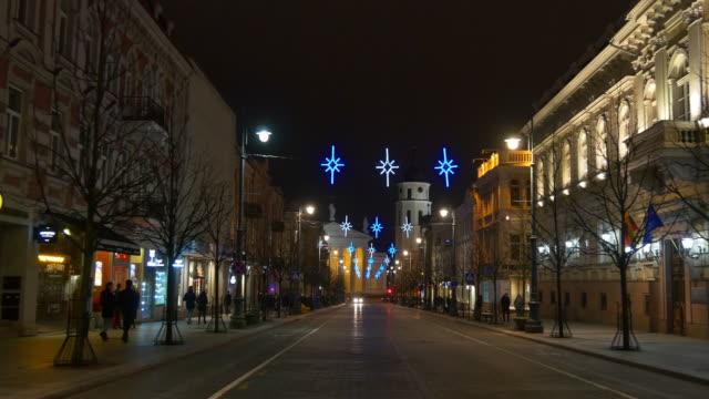 lithuania night time vilnius city famous gediminas avenue sidewalk panorama 4k video