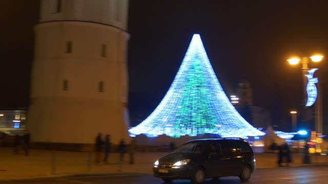 lithuania vilnius christmas holiday illuminated market traffic square street panorama 4k video