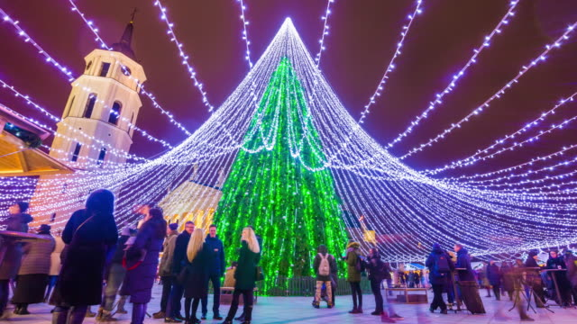 lithuania vilnius city famous christmas holiday tree illuminated market square crowded panorama 4k time lapse video