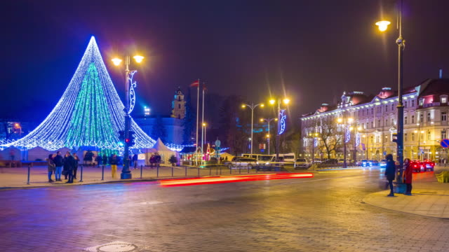 lithuania vilnius city famous christmas holiday tree illuminated market square traffic panorama 4k time lapse video