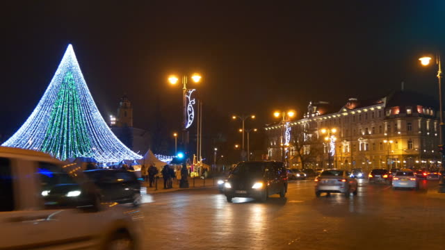 lithuania vilnius city famous christmas holiday tree illuminated market square traffic panorama 4k video