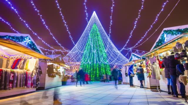 lithuania vilnius famous christmas holiday tree illuminated crowded market panorama 4k time lapse video
