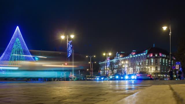lithuania vilnius famous christmas holiday tree illuminated market traffic street panorama 4k time lapse video