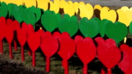Lithuanian flag made of painted hearts on sticks video