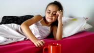 Litlle girl with fever drinking tea video