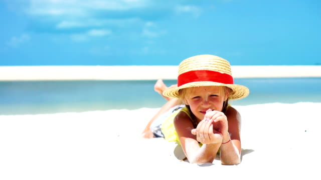 Little adorable girl in hat at the beach during caribbean vacation. SLOW MOTION. video