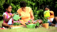 Little African American Girls Gardening with Mom video