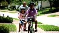 Little African American Girls Learning to Ride a Bike video