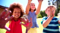 Little Afro girl showing hands full of blue paint video