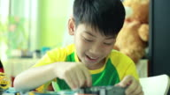 Little Asian children playing with blocks video