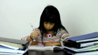 Little Asian Girl Doing Her Homework video