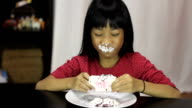 Little Asian Girl Eating Yummy Chocolate Cupcake video