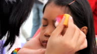 Little Asian Girl Has Eyes Face Painted video