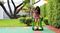 Little asian girl riding fast a push Carting video