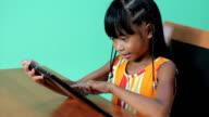 Little Asian Girl Uses Digital Tablet video