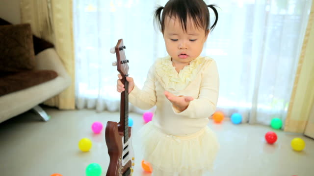little asian girl with guitar video